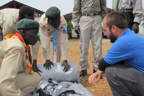 ShelterBox Response Team (SRT) member Eric Deluca (US) running through a tent demonstration with the South Sudan Scouts Association, South Sudan, June 2013.