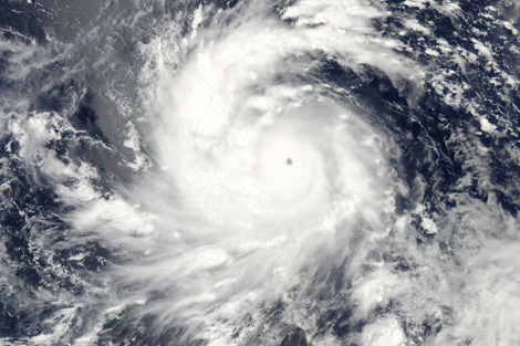 Typhoon Utor made landfall as a Category 3 storm over the northern Philippines in the early morning hours of August 12, 2013.  Image courtesy of Nasa/Earth Observatory.