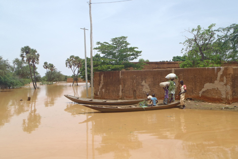 A family uses a boat to get around due to flooding in Niamey, Niger, August 2012.