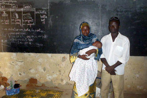 Saidou Issa (right) with his wife and 2-month-old baby. They lost their home in the floods, Niamey region, Niger, September 2013.