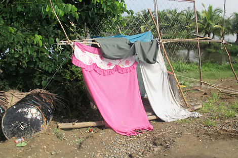 The makeshift shelter Evangeline and her two daughters were sleeping in before they were given a ShelterBox tent, Philippines, September 2013.