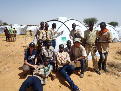 SRT members, Lodovicia Tranchini (IT) & Peter Pearce (AU) train local scouts how to erect ShelterBox relief tents.
