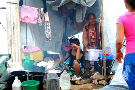 Families are living in makeshift shelters having been driven from their neighbourhoods by civil unrest, Zamboanga City, Philippines, September 2013.