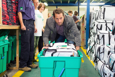 Celebrity supporter Ben Ainslie packing a ShelterBox at the charity's headquarters, Cornwall, UK, October 2013.