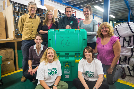 Ben with ShelterBox volunteers and staff who assisted him with the box pack, ShelterBox headquarters, Cornwall, UK, October 2013.