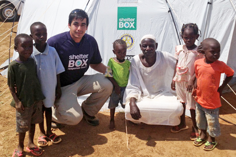 SRT member Richard Loat (CA) with a family in Sudan in front of their ShelterBox tent having lost their home in flash floods, Khartoum, Sudan, September 2013.