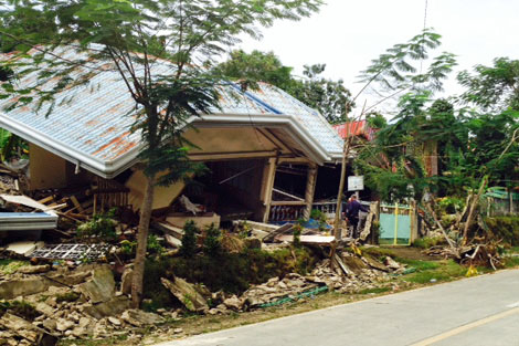 One of the tens of thousands of homes damaged by the quake that hit on 15 October, Bohol, Philippines, October 2013.