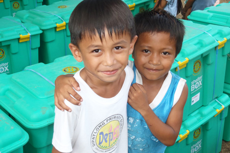 Two children remain resilient despite the earthquake and typhoon.