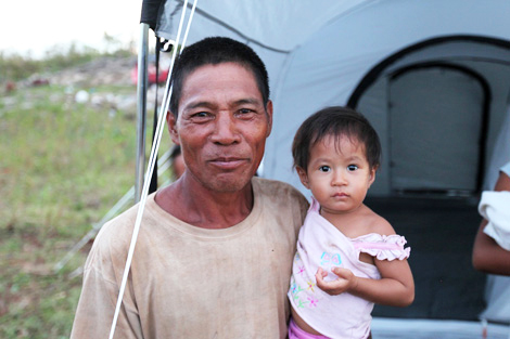 Jeremiah, his daughter Jingle Heart and their family have moved into a ShelterBox disaster relief tent.