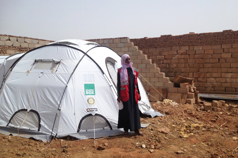 Manal, a 22-year-old widow, received a ShelterBox tent to house her six person family, Sudan, October 2013.