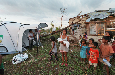 Families receive a ShelterBox tent in the Philippines