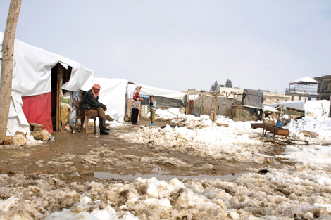 Syrian refugees living at an informal tented settlement in the Bekaa Valley, Lebanon, January 2013.