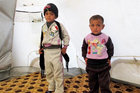 Abo Mohammad's children: 8-year-old Farah and 3-year-old Khaled, Jeb Janine, Bekaa Valley, Lebanon, November 2013.