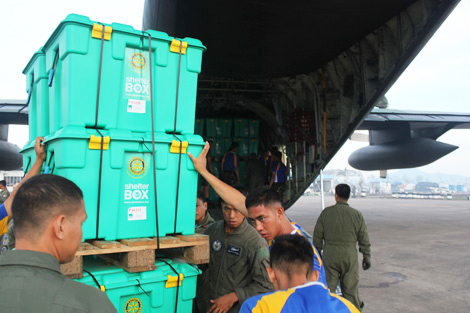 ShelterBoxes being unloaded from the C130 aircraft into Tacloban, with the help of the Philippines Navy, Philippines, December 2013. Photo by Rob Partridge.