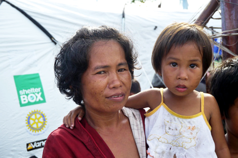 Diana with her youngest child happy with their new shelter, southern Leyte, Philippines, December 2013.