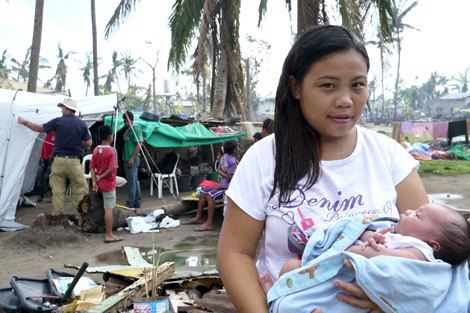 Christine Mae Ofiasa and her fourteen-day old baby, Rona Mae, are among the recent recipients of a ShelterBox tent, Bantayan, Philippines, December 2013.