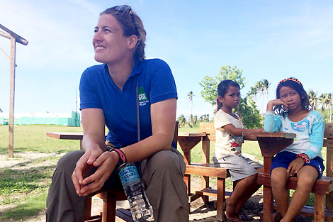 Anne with children on Kinatarcan Island, Philippines, January 2014.