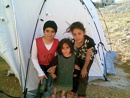 Syrian refugee children in front of their new ShelterBox tent, Fekha, Lebanon, November 2013.