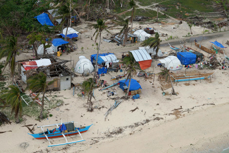 Photo credit: Joseph A Ferris III, Young Pioneer Disaster Response. An aerial view of Santa Fe, Bantayan island, Philippines. Families live in ShelterBox tents whilst rebuilding their homes that were destroyed by Typhoon Haiyan, January 2014.