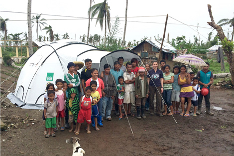 Response Team volunteer Marie Vincent with members of the Esperanza family and some of the other villagers in Cancajara, Leyte, Philippines, January 2014.