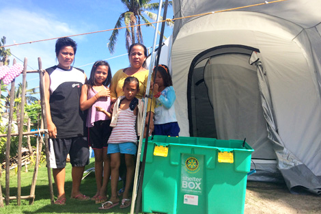 Joewe is pictured on the far left and she is with one of her sisters and three children, who received a ShelterBox tent, Philippines, January 2014.