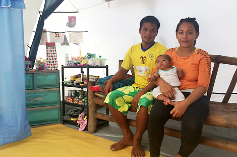 Hazel, baby Yole and her husband call their Shelterbox tent 'home', Kinatarcan, Philippines, January 2014.