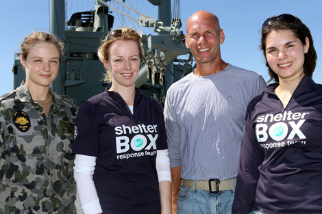 ShelterBox Reponse Team members Alice Jefferson (left-centre) and Ayeasia Macintyre (right) among Australian Naval staff. Photo courtesy of the Australian Navy.