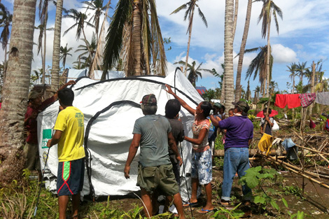 Tri-service support enables aid transportation to remote areas bringing shelter to Typhoon Haiyan survivors.
