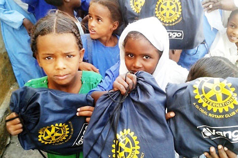 Displaced Sudanese school children with their ShelterBox activity packs, White Nile state, Sudan, December 2013.