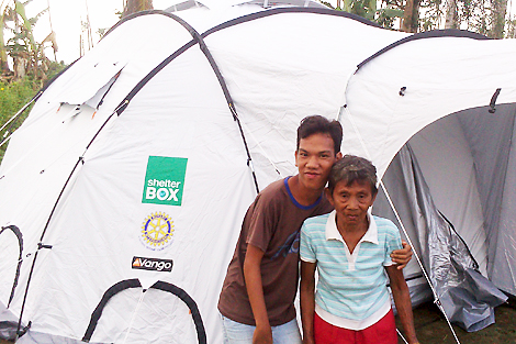 Luncia and Joseph Tragura with their new shelter, Dagami municipality, Leyte, Philippines, February 2014.