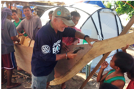 Response Team volunteer Peter Pearce helps fix some more fishing boats on Kinatarcan island, January 2014, Philippines.
