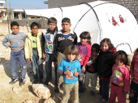 BEKAA VALLEY, LEBANON. November 2013. Of the current Syrian refugees, more than 1.3 million are under the age of 18. Syria's children, both refugees and those internally displaced, desperately need access to basic necessities like shelter as well as education. (Rebecca Novell/ShelterBox)