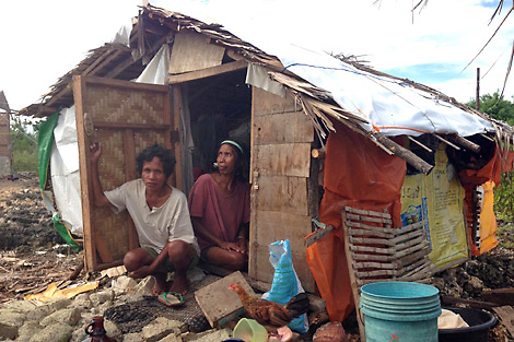 BANTAYAN ISLAND, VISAYAS, PHILIPPINES. Families are living in makeshift shelters, built from the remains of their previous homes and any other materials that they can find. (Anne Seuren/ShelterBox)