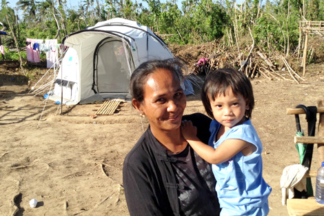 PANAY/PHILIPPINES. March 2014. Milagros Araque, mother of three, lost her husband during Haiyan whilst he was overseeing the island's fishing ponds. Her hope and courage was inspiring. (Matt White/ShelterBox)