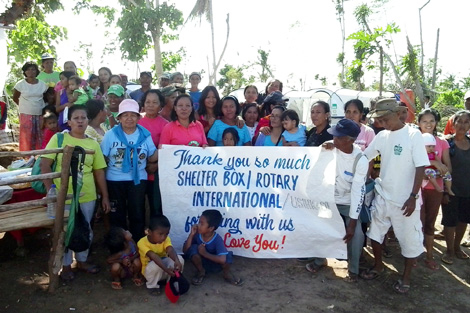 PANAY/PHILIPPINES. March 2014. Members of Agsam community moments before the celebration they held when ShelterBox returned to carry out the final tent inspection (Matt White/ShelterBox).