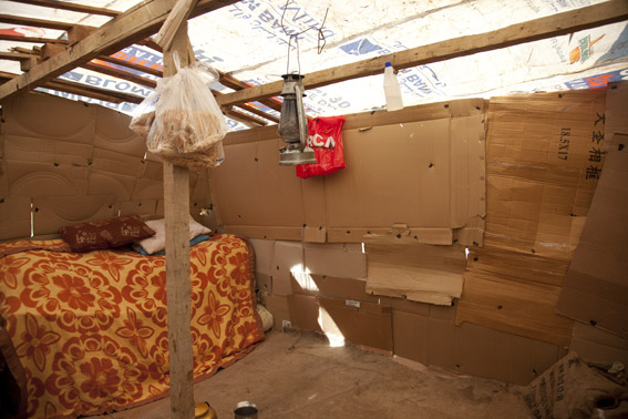 Inside a makeshift refugee shelter, West Bekaa, Lebanon, home to a single mother and 5 children.