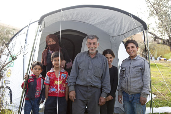 Syrian Refugee family with their Shelterbox tent at Kousha, Northern Lebanon