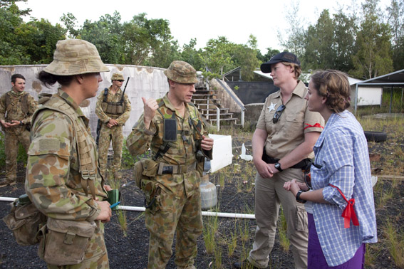 "Officers from 2RAR negotiate with the ""Mayor' and 'Police Chief' of Cowley Island."