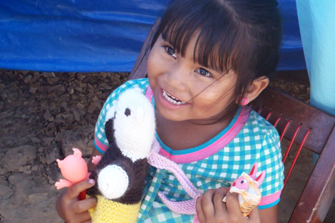 BOLIVIA/TRINIDAD. MAY 2014. One of the many children who received a teddy bear as part of their family's ShelterBox aid package, bringing them a sense of normality that is important during times of trauma. All the bears have been hand-knitted in Cornwall, UK, where ShelterBox headquarters are located. (Jon Berg/ShelterBox).