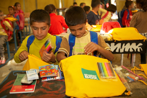 IRAQI KURDISTAN. 29 OCT 2013. SchoolBoxes have been distributed at the Quashtapa refugee camp near Irbil. Over 2.6 million refugees have fled across the Syrian border into neighbouring countries. (Simon Clarke/ShelterBox).