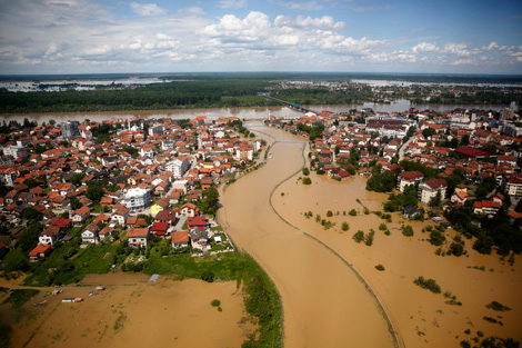 BRCKO, BOSNIA AND HERZEGOVINA. 18 MAY 2014. An aerial view of the flooded city of Brcko, where at least 24 people have died in the worst floods in over a century. Image courtesy of REUTERS/Dado Ruvic.