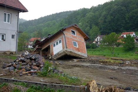 KRUPANJ, SERBIA. June 2014. An example of how the flooding has damaged housing in the region. (Torstein Nielsen/ShelterBox)