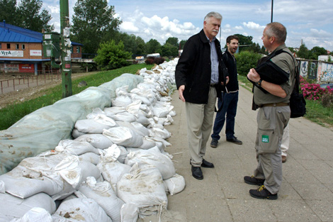 SERBIA. June 2014. Response team volunteer Torstein Nielsen (right) assessing the need in the region. Sandbags were used in an attempt to resist the floodwaters. (Colin Bradbury/ShelterBox)