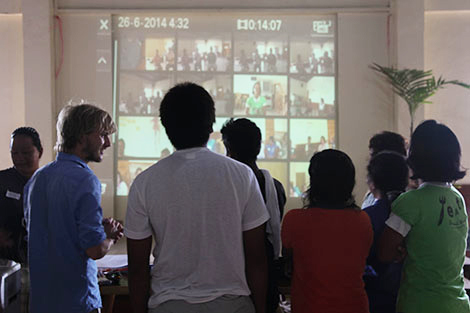 Bantayan town municipal hall, Bantayan island. June 2014. The participants watch each other's videos. The workshop relies on experiential learning; lessons are learnt through doing so and watching back through the videos is a really important part of the process. (Toby Ash/ShelterBox)