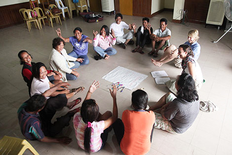 Bantayan town municipal hall, Bantayan island. June 2014. Participants work together to write a group agreement. This shared document will determine how they work together throughout the project. (Toby Ash/ShelterBox)