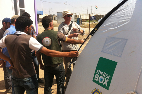 IRAQ KURDISTAN. SEPTEMBER 2013. Coordination with other aid agencies has been imperative in ShelterBox's responses in Syria and Iraq Kurdistan. Here is ShelterBox response team member Torstein Nielsen checking tents with local Kurdish partner Barzani Charity Foundation. (ShelterBox)
