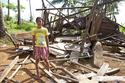 Lady stands infront of the remains of her house, destroyed by Typhoon Glenda, in rural Banquerohan, Albay, Philippines. Her husband is farmer and they have 8 children.