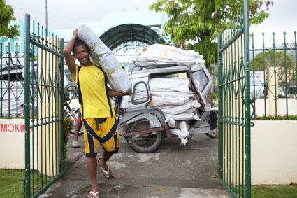ShelterBox aid is transported by motorcycle taxi, Rapu Rapu, Albay, Philippines