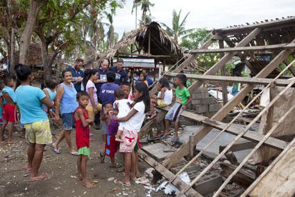 SRT members (L-R Harry Roberts, Jon Berg and Matt Roberts all UK) conduct a needs assessment on Rapu Rapu Island, Albay, Philippines