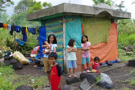 Philippines July 2014. The Alaurin family have been living in this bus shelter since Typhoon Rammasun destroyed their home. (Chris Alderson/ShelterBox).